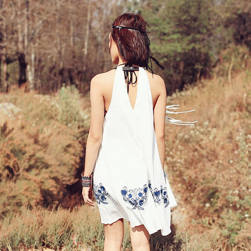 迷阵夏季新款民族风短裙宽松显瘦性感A字裙绣花流苏吊带连衣裙