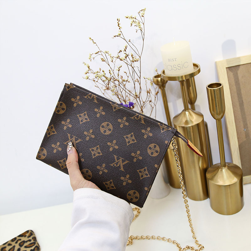 手拿包男女通用斜跨链条包信封包洗漱包欧美时尚明星同款男士夹包