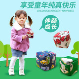 Nursery pupils throwing sandbags children grasping mini sandbags sandbags canvas handmade toys parent-child interaction