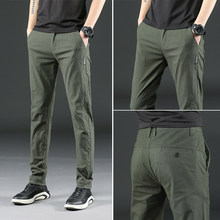 New winter men's casual pants Slim Straight stretch Korean teenagers plus velvet pants tide wild men