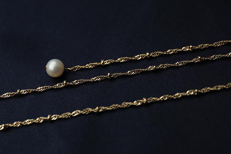 s  男女同款挂脖秋冬新款珍珠吊坠眼睛链 24k Dan ` 复古手作天然珍珠