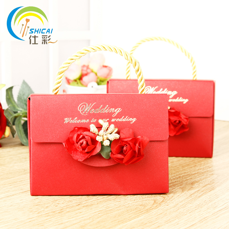 shi cai chinese new year candy european creative wedding candy box gift bag laptop bag packaging supplies wedding gift