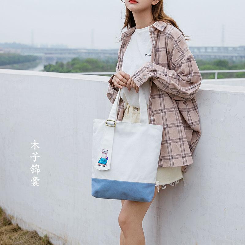 木子锦囊帆布包女单肩ins手提简约韩版学生文艺森系白色帆布包女