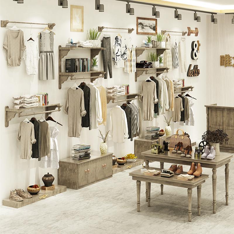 童装复古服装店展示架上墙壁挂衣架衣服店装修效果图男女装店货架