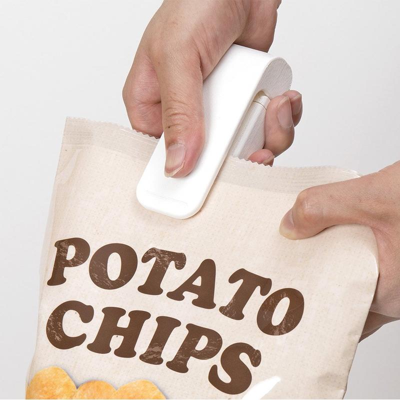 日本便攜迷你封口機食品塑封機零食塑料袋密封機家用手壓熱封機