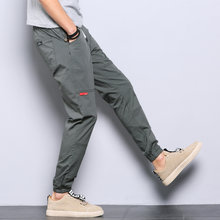 Men's casual pants, autumn tide brand tooling, long pants, spring and autumn models, all-match elastic pants, nine-point pants