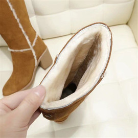 北方冬季羊皮毛一体雪地靴高筒靴真皮羊毛粗跟马丁靴高跟长靴子女