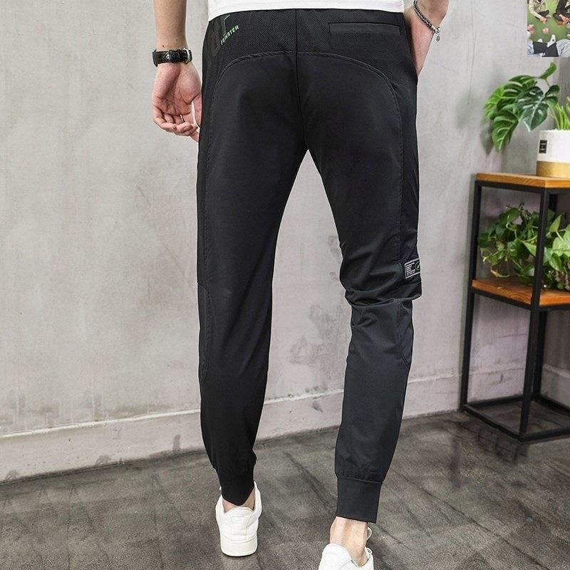 庄织装只支男裤运动休闲裤小脚裤男士冰丝裤 庄织服装服饰厂家。