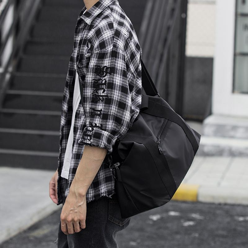 我潮旅行包男手提韩版短途行李袋登机包大容量健身包男士单肩斜挎