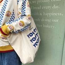 唐糖包袋秋冬自制经典小众蓝色字母单肩手提薄款米色大容量布包