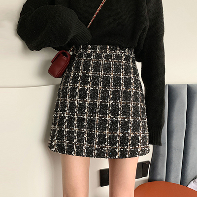 taobao agent Spring and Autumn 2020 new Korean version of the crotch skirt is thin, all-match plaid skirt high waist bag hip A-line skirt female