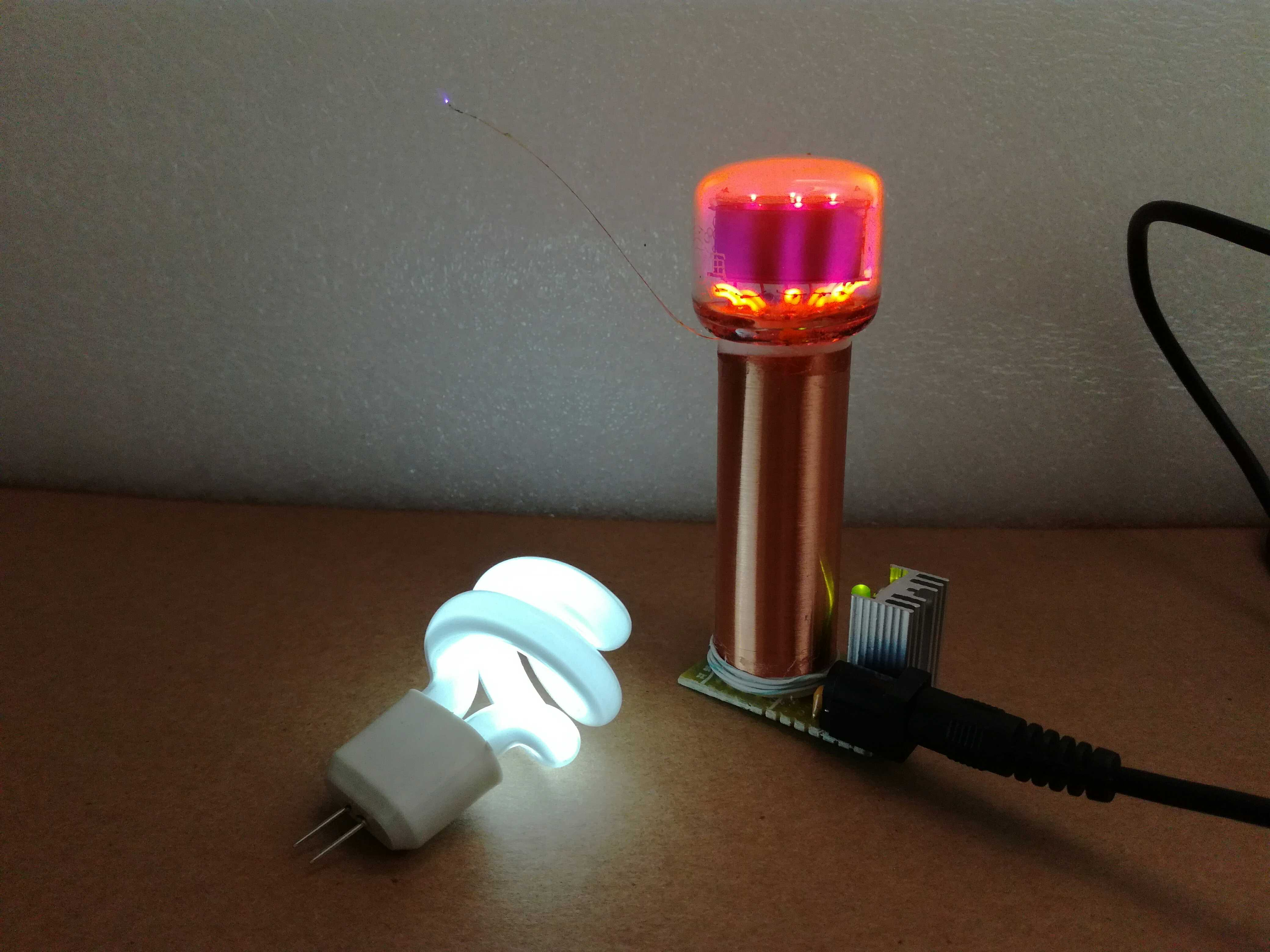 High Quality The Product Comprises A Tesla Coil, A Power Supply, A Glow Tube, And A  Small Energy Saving Lamp Tube.