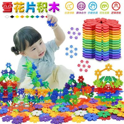 Children's toys, big snowflakes, blocks, hood, pile, boy, assembling thick snow, green toys