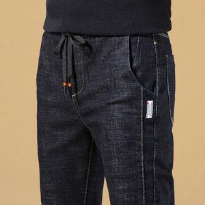 秋冬季新款男士牛仔裤男弹力修身小脚裤韩版青年休闲男裤黑色裤子