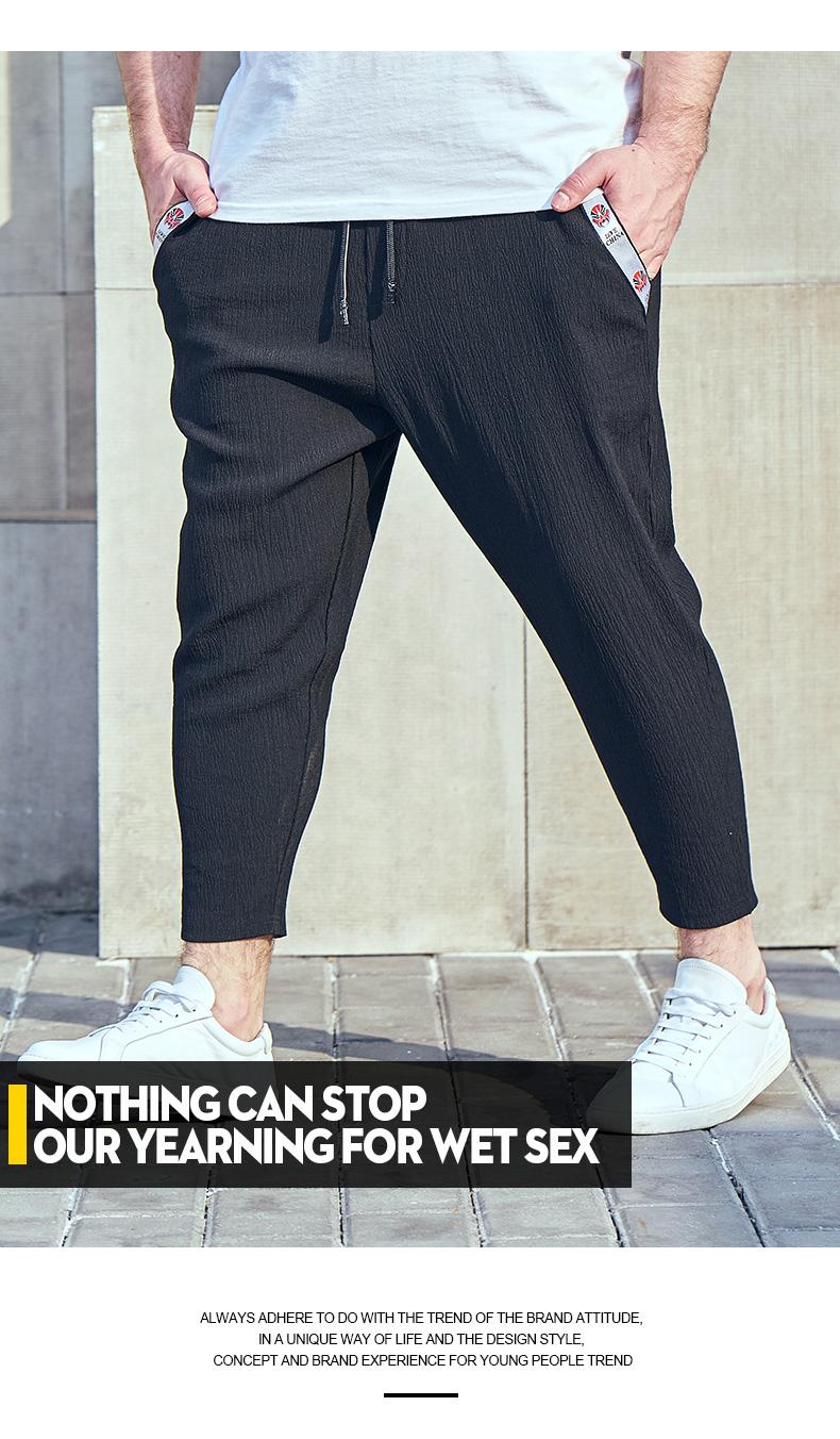Đen Jin mã lớn nam mùa hè mới triều chất béo quần âu cộng với phân bón để tăng của nam giới chín quần harem lỏng quần