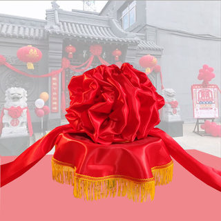 Opening of the ribbon-cutting flower ball unveiling the red silk cloth awards corsage wedding hydrangea car new car big red stone lion flower