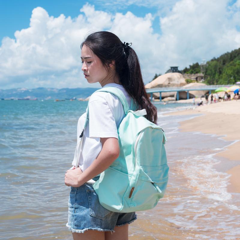 高中学生书包女双肩包2016轻便防水旅行包大容量纯色帆布情侣包韩