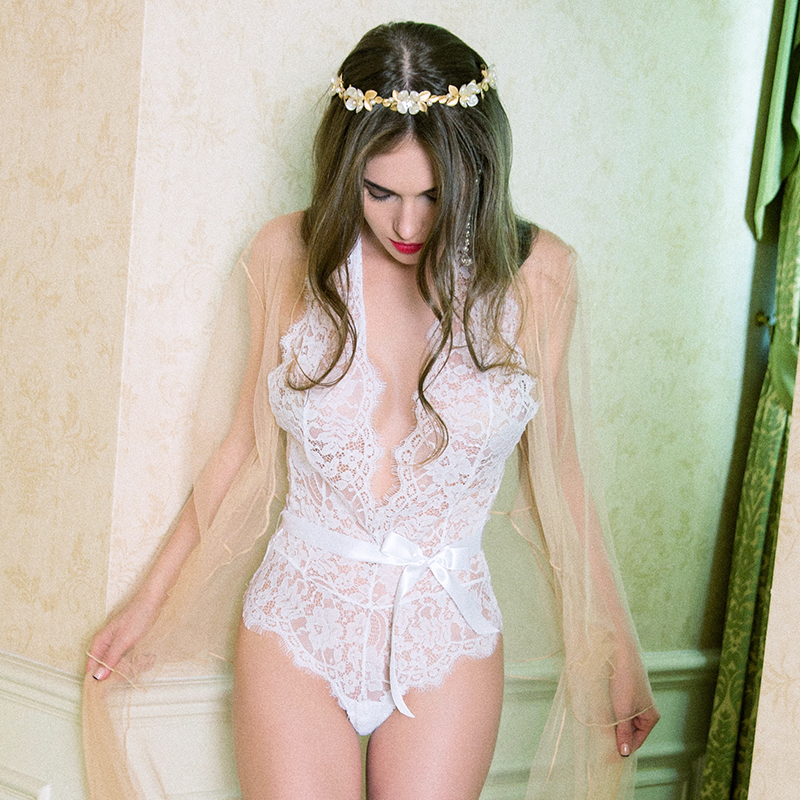 0a428139e8 Europe and the United States new white lace hanging neck deep V bare back  nude jumpsuit sexy photo transparent temptation pajamas