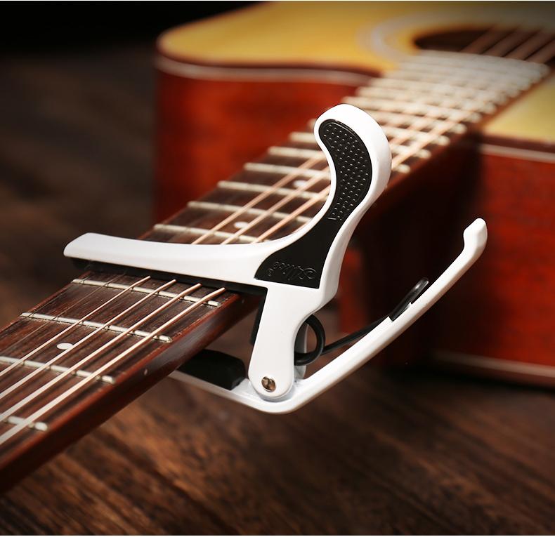 正品爱丽丝合金民谣吉他移调夹黑白可选包邮送拨片详细照片
