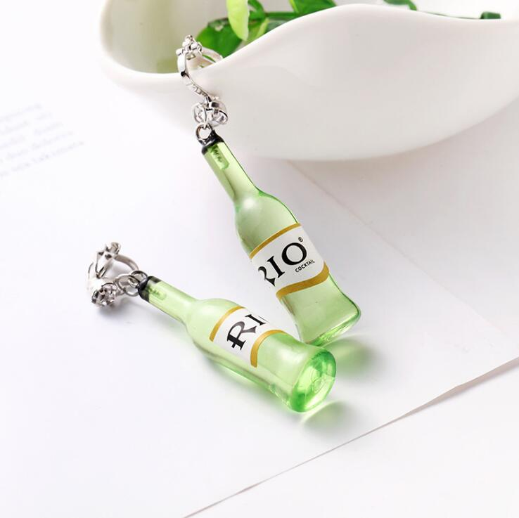 WHITE EAR CLIP GREEN BOTTLE
