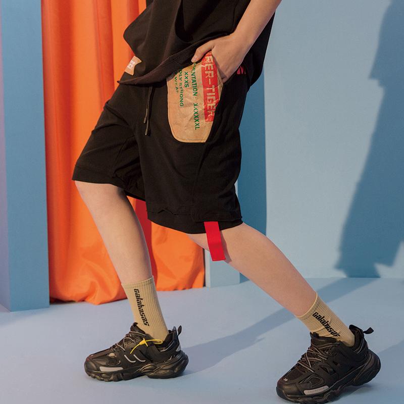 DCFJ thủy triều thương hiệu hip-hop năm điểm quần giấy kraft túi màu đen quần short thể thao giản dị xu hướng 5 điểm giữa quần mùa hè - Quần short