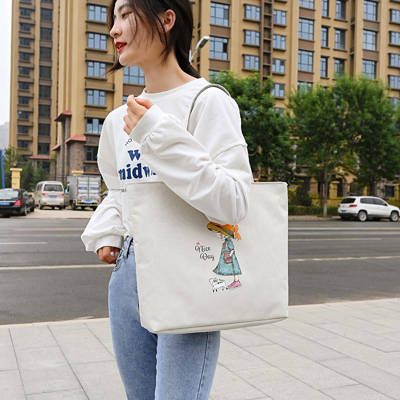 帆布包女单肩学生大容量手提购物袋2021年新款夏季日系手拎布袋包(帆布包女韩风单肩学生大容量购物袋)