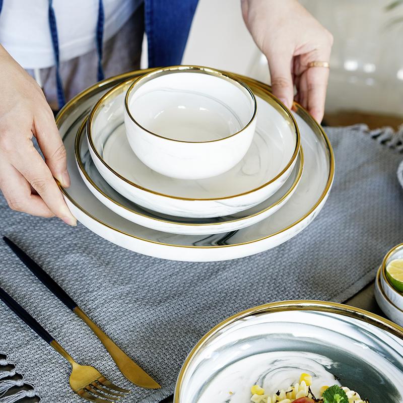 Bản năng phong cách Bắc Âu cẩm thạch mạ vàng bộ đồ ăn hộ gia đình khay cơm bát bát súp bát đĩa gốm