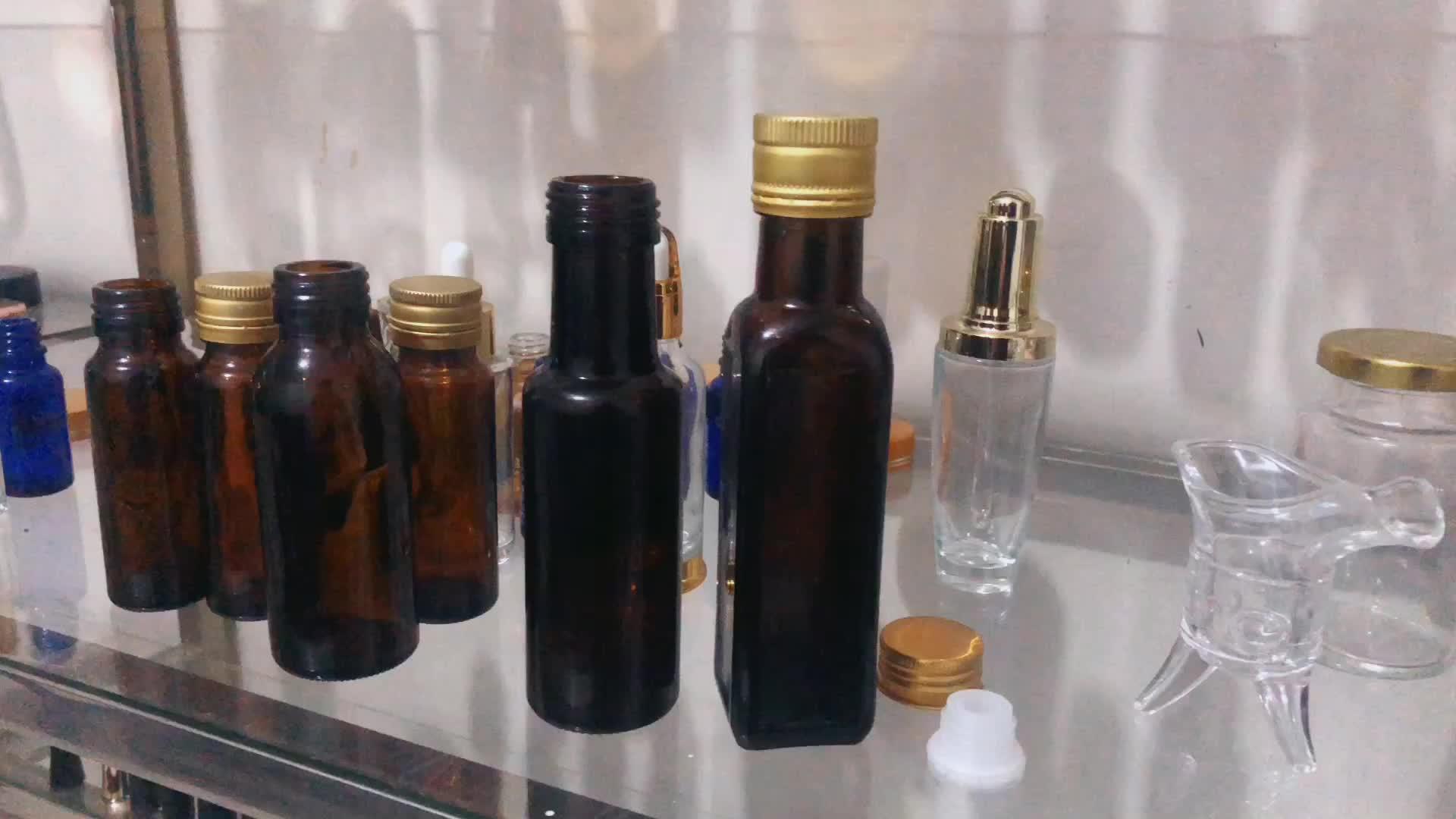 Fabrika doğrudan özelleştirilmiş cam şişe kamelya yağı şişesi zeytin sirke boş şişe