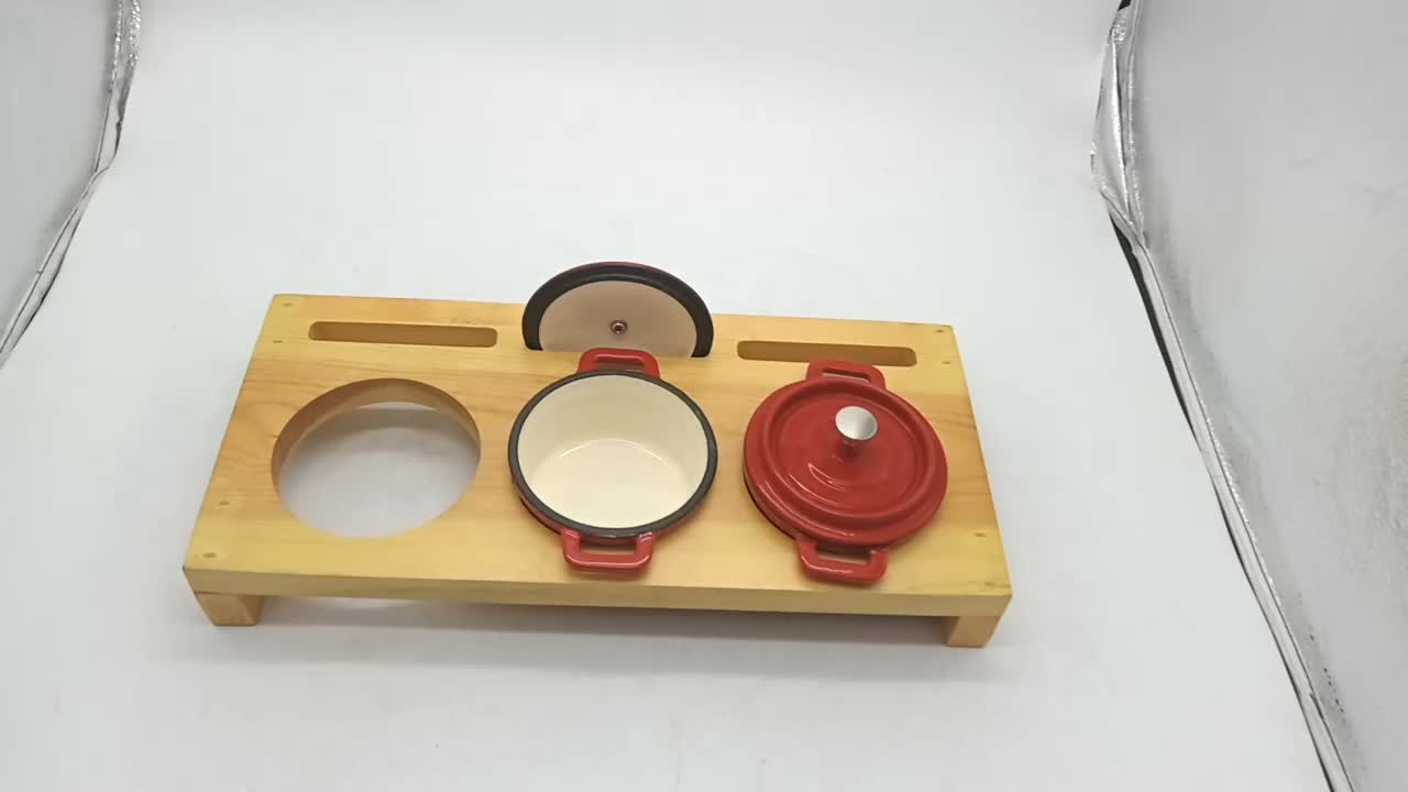 Red Enamelled cast iron cookware set with Black wooden pot holder