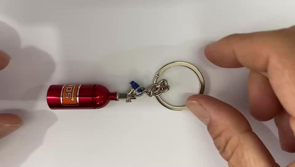 حار بيع في الامازون الإبداعية NOS البسيطة أكسيد النيتروز زجاجة كيرينغ مفتاح الدائري سلسلة الموجودة في قاعدة المفتاح خبأ حبة مربع تخزين توربو المفاتيح