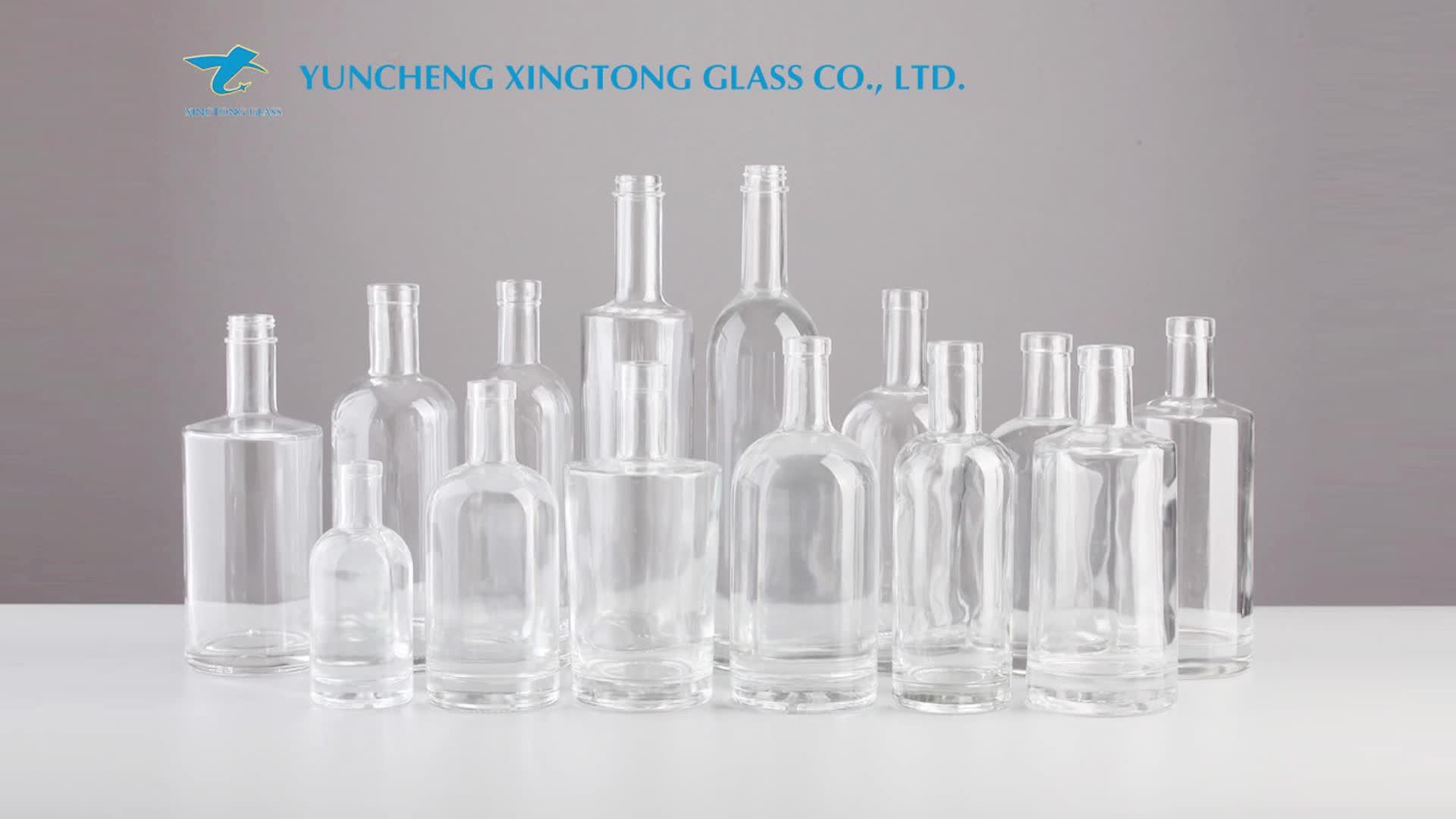 Venta al por mayor de fábrica, elegante, botella de cristal de Gin personalizada para tapones