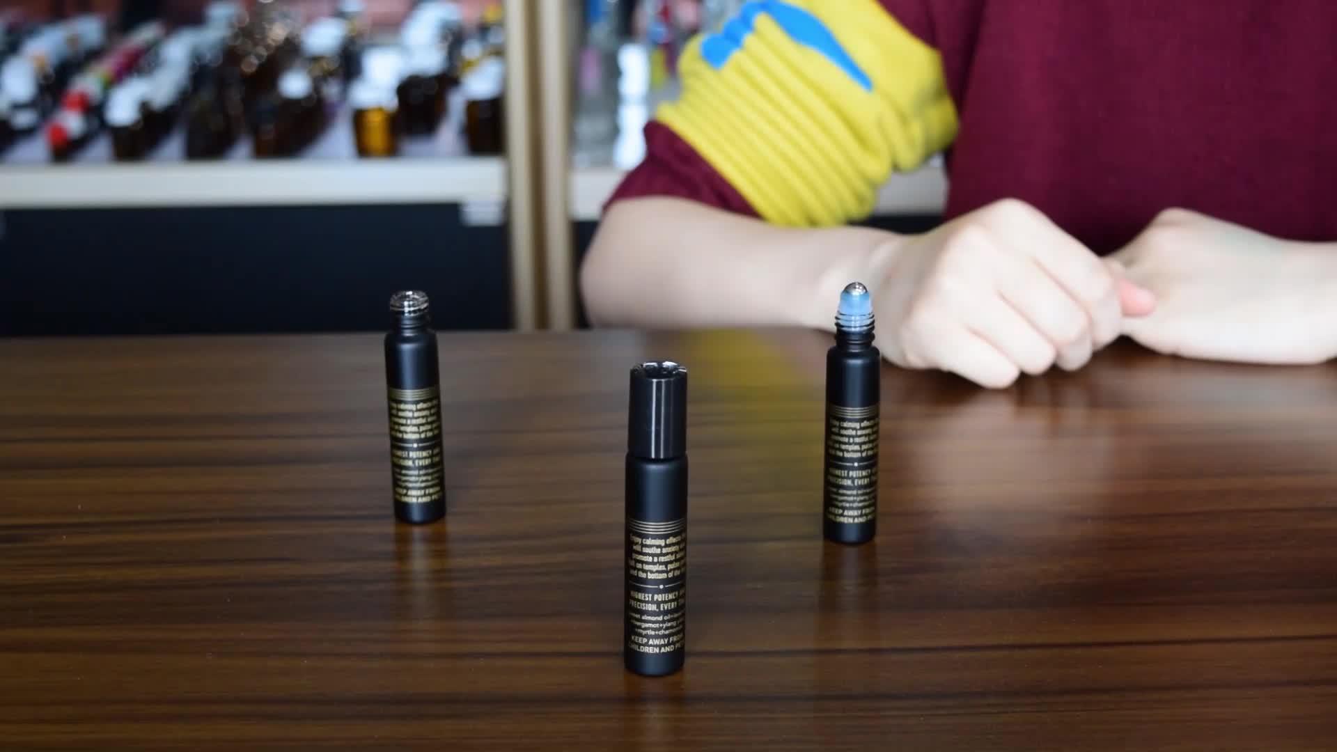 マットブラックガラスチューブ香水消臭ボトルに 10 ミリリットルステンレス鋼ロールボトルエッセンシャルオイル梱包