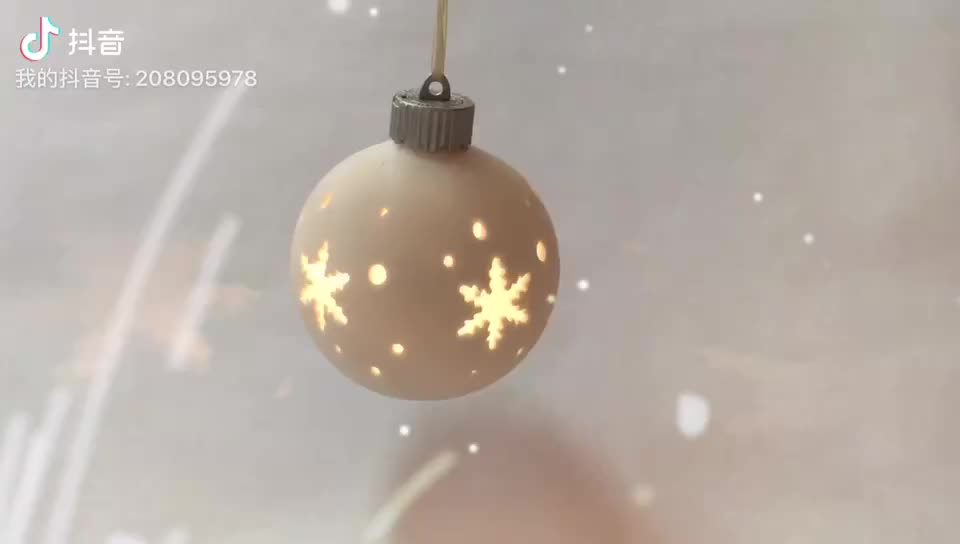 Nice hollow carved snow ceramic ball with LED light hanging decoration