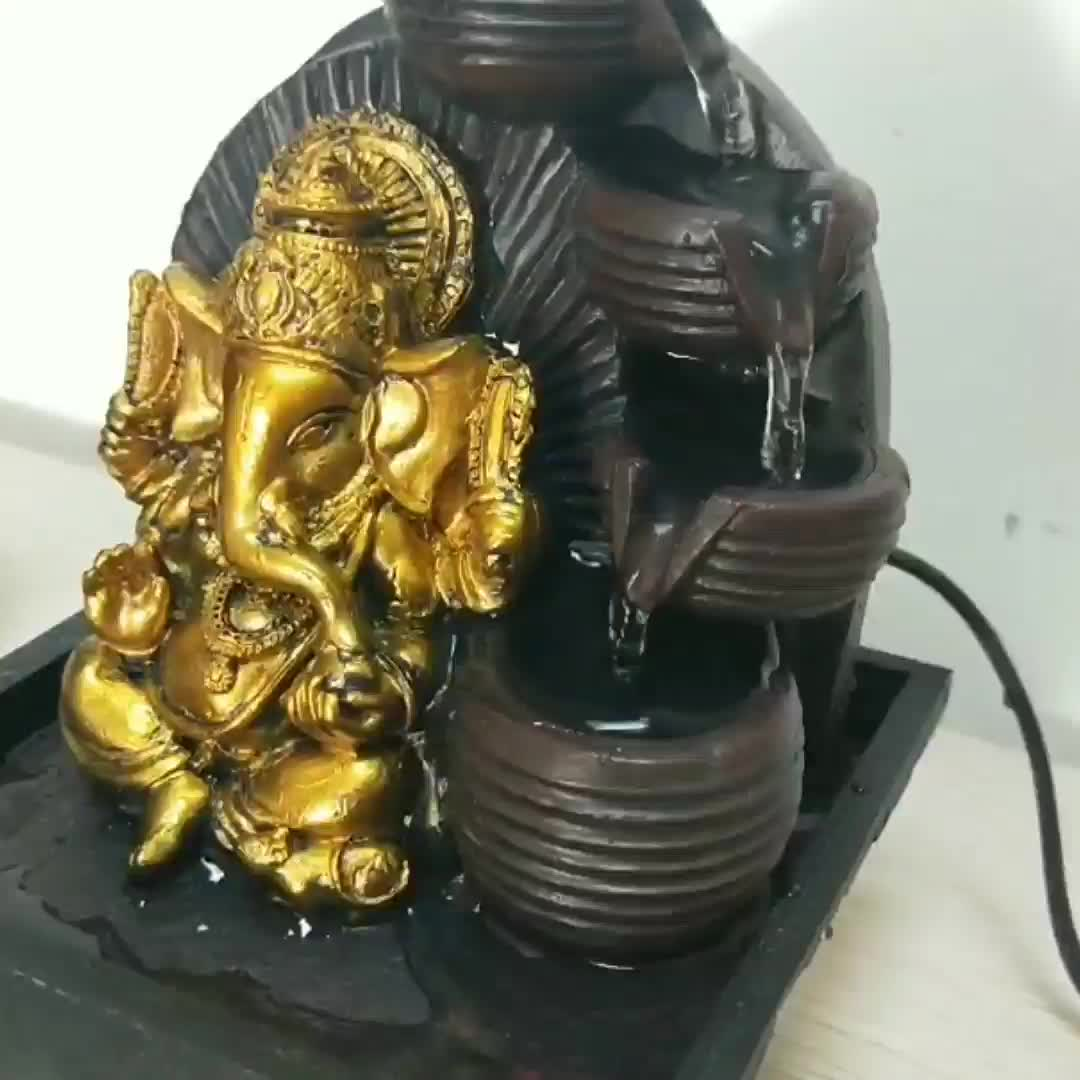 hindu god ganesh statue indoor water fountains india