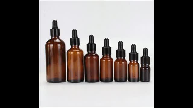 Amber glass dropper bottles with child resistant caps packaging