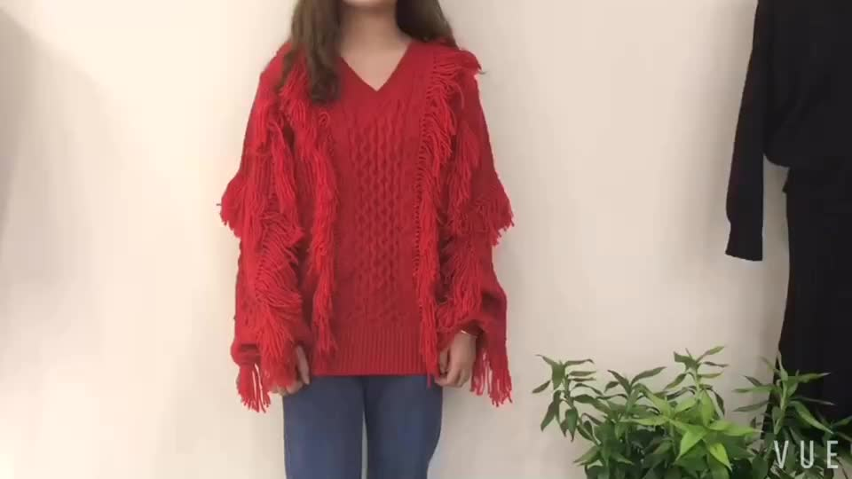 woman lantern sleeve cable knit twist pullover fringe sweater