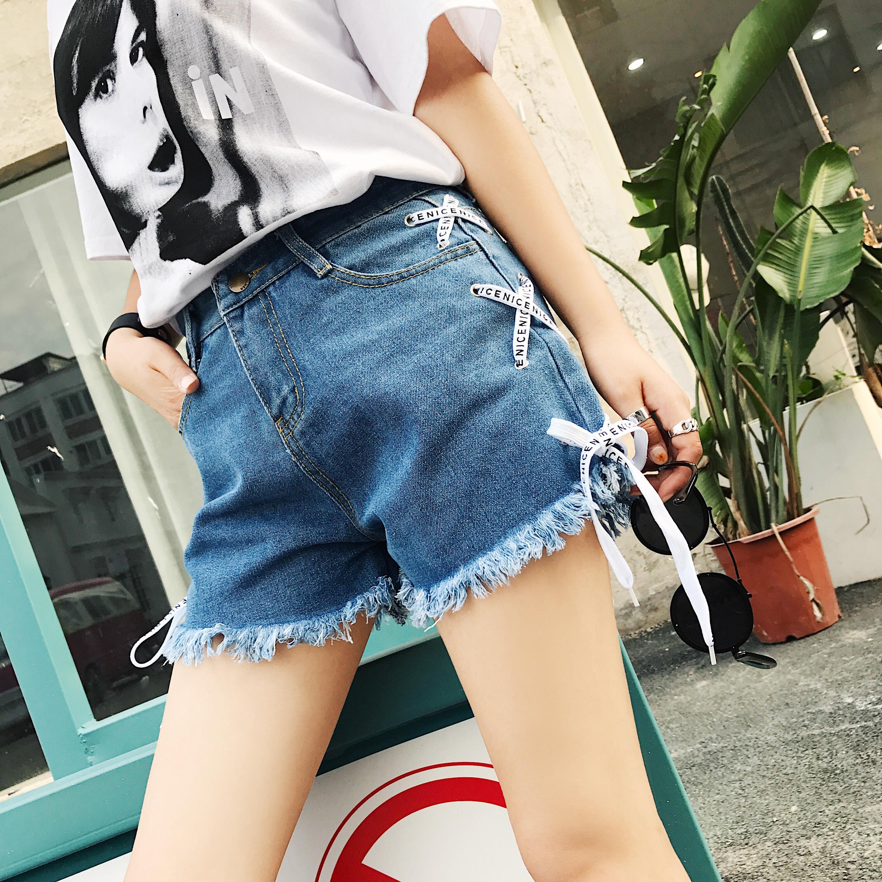 實拍夏季新款牛仔褲 側邊交叉綁帶須須邊短褲時尚熱褲超短褲