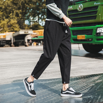 2017 autumn new wild casual pants male loose Harlan sports pants Korean version of the trend of students large size nine pants