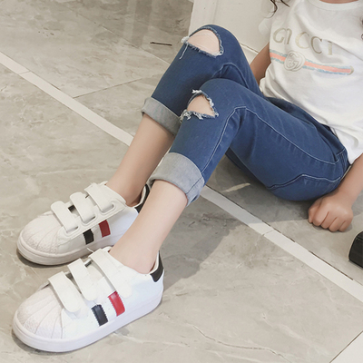 Girls jeans autumn 2017 new children's clothing Korean version of the hole trousers children's skinny feet pants