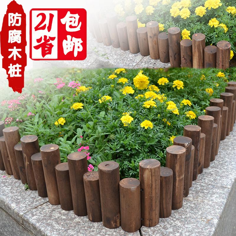 Клумба из деревянных колышков фото