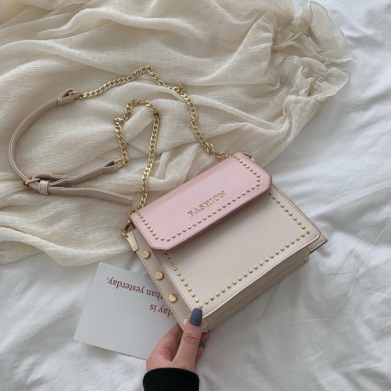 法国包包女2019新款韩版时尚铆钉单肩斜跨包时尚链条小方包包