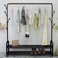 A shelf for hanging simple household clothes in the bedroom