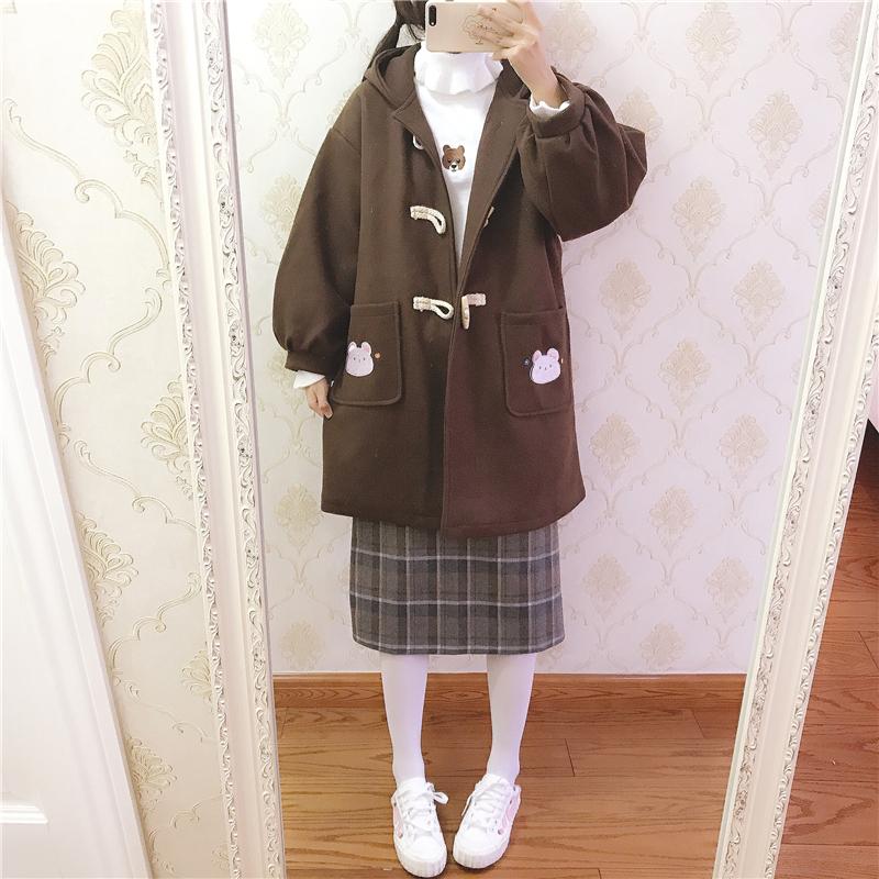Áo khoác dạ nữ hình gấu ở túi