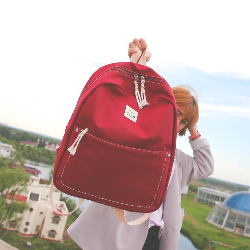纯色帆布双肩包女日韩版学院风高中生旅行双肩背包初中学生书包女