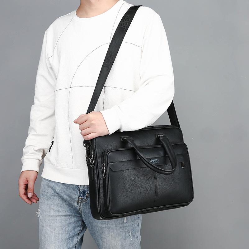 阿南真皮皮包JEEP吉普手提包男士手拿商務公文包橫款休閒皮包包包電腦包潮男包