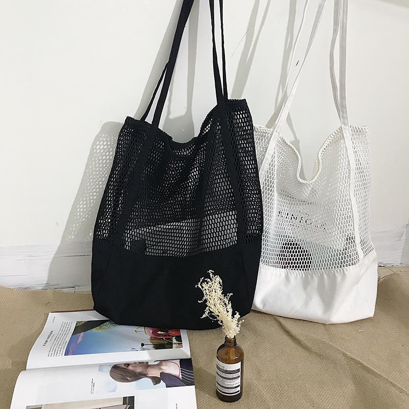 2019夏季新款韩版网格手提包购物袋网眼镂空沙滩包帆布单肩女包包