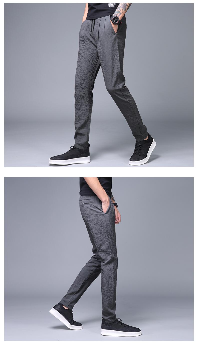 Quần nam mùa hè phần mỏng chân người đàn ông Hàn Quốc phiên bản của xu hướng băng lụa hậu cung quần mùa hè lỏng siêu mỏng mùa hè quần âu