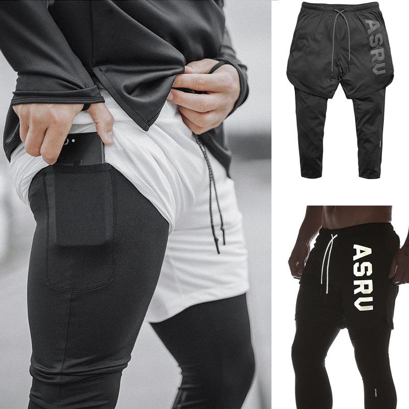 2019新款弹力裤子训练兄弟男高肌肉速干假2件9分裤运动男健身短裤