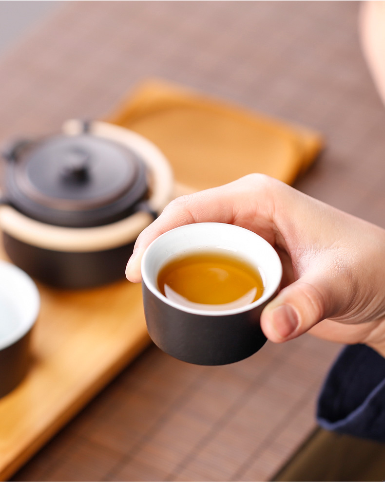 Japanese kunfu tea, black pottery a pot of tea cup crack cup two people is suing travel tea set ceramic with portable bag