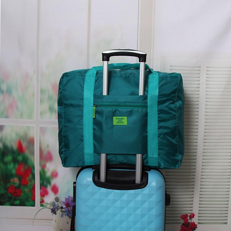 Túi lưu trữ du lịch Hàn Quốc Quần áo xách tay có thể được đặt trên túi hành lý xe đẩy túi quần áo di động không thấm nước - Túi du lịch